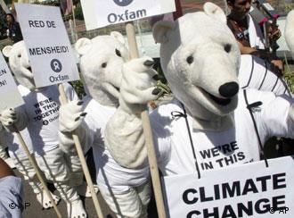Environmental activists dressed as polar bears demonstrate