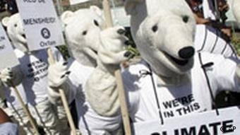 Environmental activists dressed as polar bears demonstrate in front the of the conference center