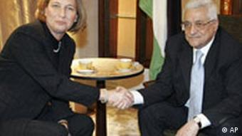 Israeli Foreign Minister Tzipi Livni, left, shakes hand with Palestinian president Mahmoud Abbas