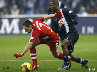 Bayern's Franck Ribery, left, and Berlin's Gilberto challenge for the ball during the German first division Bundesliga soccer match between Hertha BSC Berlin and FC Bayern Munich in Berlin, Germany, Saturday, Dec. 15, 2007.