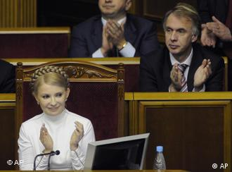 New Prime Minister, Yulia Tymoshenko, gives her victory the thumbs' up