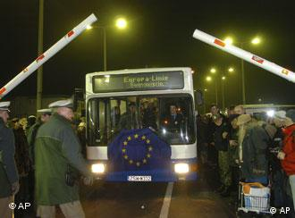 The first bus from the Polish city of Swinemuende is ready to pass under dismantled border barrier on the German-Polish border in Ahlbeck, northern Germany
