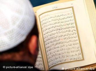 Man reading Koran
