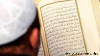 A man studies the Koran