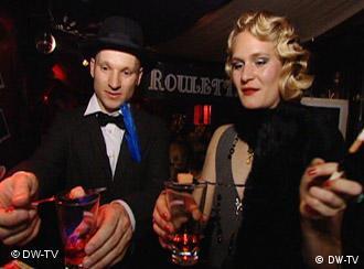 Two people drink absinthe
