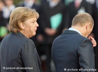 Фото из архива: Ангела Меркель и Владимир Путин