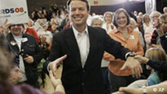 Democratic presidential hopeful former Sen. John Edwards greets an audience in Ames, Iowa