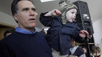 Republican presidential hopeful former Massachusetts Gov. Mitt Romney, right, holds his grandson