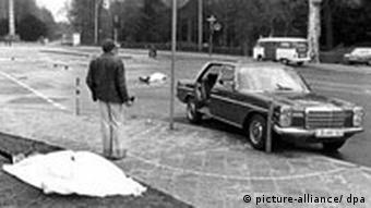 Black and white image of a crime scene with a Mercedes