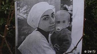 A picture of Hatun Sürücü, holding her baby boy, placed at the site of her murder