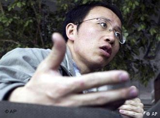 **FILE** Outspoken Chinese AIDS activist Hu Jia gestures during an interview at a cafe in Beijing, in this March 31, 2006 file photo. Hu was charged with subverting China's government after security officers barged into his home and took him away, a watchdog group and lawyer said Saturday, Dec. 29, 2007. (AP Photo/Ng Han Guan, File)