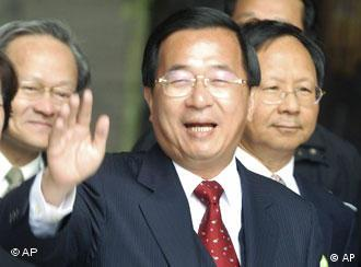 Taiwan's President Chen Shui-bian smiles to press at the opening ceremony of the National Taiwan Democracy Memorial Hall, Tuesday, Jan. 1, 2008, in Taipei, Taiwan. The National Taiwan Democracy Memorial Hall is newly reopened from the former Chiang Kai-shek Memorial Hall which was built by the Nationalist (KMT) government to commemorate Chiang Kai-shek. (AP Photo/Chiang Ying-ying)