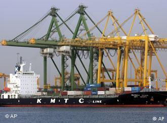 A cargo ship unloads at a marina