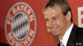 Juergen Klinsmann faces the media next to the club's logo at a press conference in Munich, southern Germany, Friday, Jan. 11, 2008.