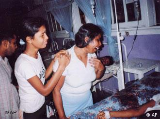 Unidentified relatives of victims of a bomb blast wail at a hospital in Buttala, 150 miles southeast of Colombo, Sri Lanka