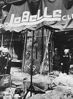 Firemen searching through debris after the 1986 bomb attack at the La Belle.
