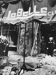 firemen searching through debris after a bomb attack at the Berlin dicotheque La Belle
