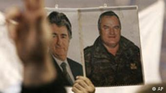 Serbian nationalists display photos showing Bosnian war crimes fugitives, Radovan Karadzic and Ratko Mladic at rally