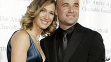 Steffi Graf, left, and her husband Andre Agassi attend the Andre Agassi Charitable Foundation's 12th Grand Slam for Children event, Saturday, Oct. 6, 2007, in Las Vegas. (AP Photo/Ronda Churchill)