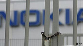 Locked gate in front of the Nokia logo