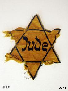 A slightly torn yellow star of David is on display at the Museum Otto Weidt's Workshop for the Blind in Berlin
