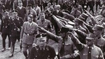 A black-and-white photo of crowds giving the Hitler salute