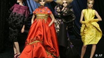 Models wearing Galliano's designs on the catwalk in Paris