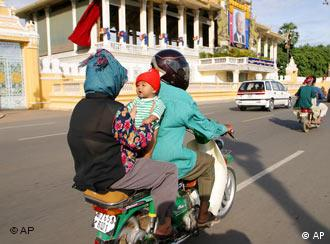 Motorbike drivers have to wear helmets but passengers do not