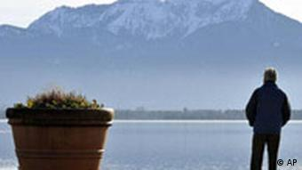 Man standing at the edge of the Chiemsee