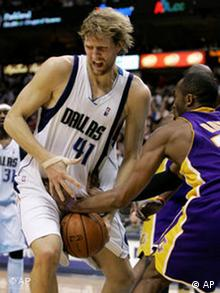 Los Angeles Lakers guard Kobe Bryant, right, knocks the ball out of the hands of Dallas Mavericks foreward Dirk Nowitzki
