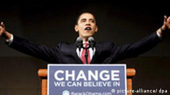 Barack Obama at a podium with the inscription change we can believe in