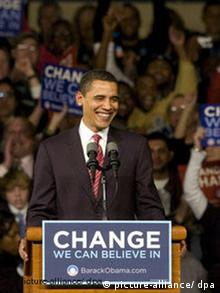 Obama smiles behind a podium with the slogan Change we can believe in