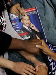 Supporters shake the hands of Democratic presidential hopeful Obama