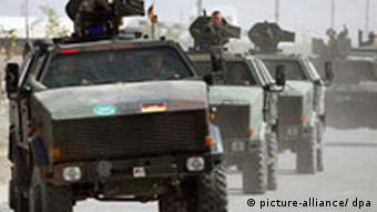 German soldiers riding in Dingo armoured vehicles patrol a road in Afghanistan