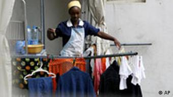 A women irons clothes (Photo: Grace Kassab)
