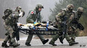 A French-German brigade carries a stretcher as part of a NATO training exercise