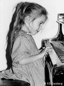 Julia Fischer as a child, playing the piano