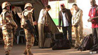 French nationals and other foreigners are evacuated by the French army from N'Djamena, Chad, Saturday, Feb. 2, 2008.