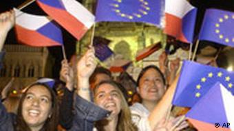 Young Czechs waving EU and Czech flags