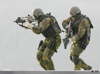 Two German soldiers take part in a training exercise