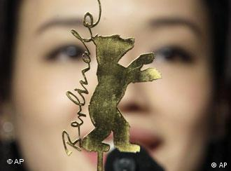 Actress Shu Qi from Taiwan stands behind the Berlinale symbol