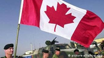 Canadian troops with the Canadian flag