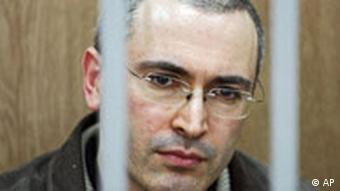 Former Yukos oil company CEO Mikhail Khodorkovsky seen behind bars at a courtroom