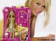 Paris Hilton behind a doll wearing clothes she picked