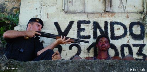 Film scene: a policeman holdsa a gun to a man's head