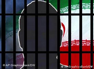 A silhouette of a man behind bars with an Iranian flag