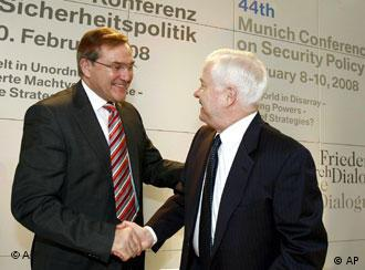 In a photo provided by the Security Conference Germany's Defense Minister Franz Josef Jung, left, welcomes US Defense Secretary Robert Gates, right, on the last day of the Conference on Security Policy in Munich, southern Germany, on Sunday morning, Feb. 10, 2008. (AP Photo/Security Conference, Sebastian Zwez, HO)