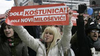 Students holding banner reading Down with Kostunica, Down with New Milosevic, during a protest rally in Belgrade, on Monday, Feb. 11, 2008