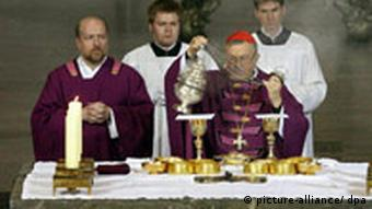 Four men participate in a Catholic mass