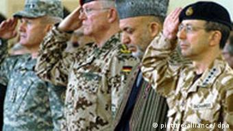 NATO 's new commander in Afghanistan U.S. General Dan McNeill, Commander Allied Joint Force Command Brunssum German General Egon Ramms, Afghan President Hamid Karzai and outgoing NATO commander in Afghanistan British General David Richards attend a change of command ceremony of NATO's International Security & Assistance Force (ISAF) in Kabul on Monday 05 February 2007